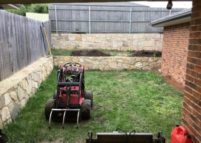 Gardengigs - Bonner Before Landscaping View of the Back Garden with Tilling Machine
